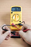 Testing circuit. Testing SATA to IDE adapter with multimeter Royalty Free Stock Photography