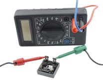 Testing  diode bridge with multimeter. On white background Royalty Free Stock Photography