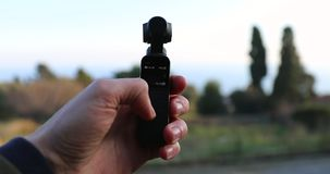 Testing DJI Osmo Pocket Camera Outdoors. Roquebrune-Cap-Martin, France - February 17, 2019: Testing DJI Osmo Pocket Gimbal Camera Outdoors, The Smallest 3-Axis stock video