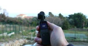 Testing DJI Osmo Pocket Camera Outdoors. Roquebrune-Cap-Martin, France - February 17, 2019: Testing DJI Osmo Pocket Gimbal Camera Outdoors, The Smallest 3-Axis stock video footage