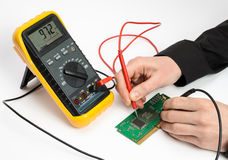 Testing Electronic. Device. Measuring by multimeter stock photos