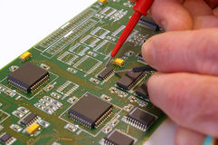 Testing electronic circuit board with test probes. Using test probes to measure points on an printed circuit board ( PCB stock image