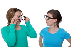 Testing glasses. Two women put on glasses and consider themselves Stock Images