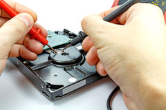 Testing hard disk drive by engineer on a white background Royalty Free Stock Photos