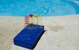 Testing kit. Swimming pool testing kit on side of pool stock photography