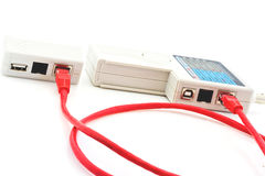 Testing of a long red network cable. By the Stock Photography
