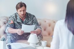 Anxious about something soldier reading test answering to psychologist Stock Image