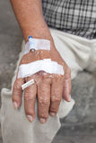 Testing medical tube in senior male hand Royalty Free Stock Photography
