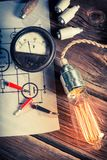 Testing power consumption by light bulb in the vintage lab Royalty Free Stock Photos