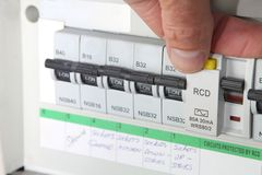 Testing an RCD Residual Current Device. Testing an RCD & x28;Residual Current Device& x29; on a UK domestic electrical consumer unit or fuse box Stock Photos