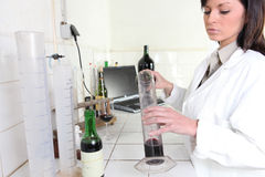Testing red wine. In a laboratory Stock Image