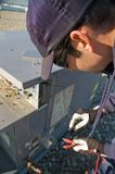 Testing roof top unit. Worker testing voltage on a buildings roof top air exchanger Royalty Free Stock Images