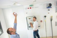 Testing the smoke detector. Smoke royalty free stock photos