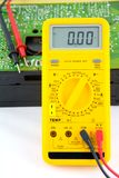 Testing a transistor radio. A view of a digital test meter or multimeter ready to be used to fault find the circuit board of a transistor portable radio stock photos