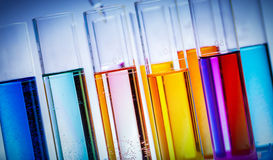 Testing tubes filled with colored substances. Royalty Free Stock Image