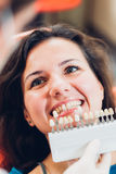 Testing whiteness of patient's tooth Royalty Free Stock Photos