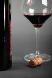 Testing wine. Still life of the bottle cork and filled red wine glass Stock Photography