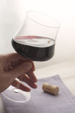 Testing Wine. Man holding and testing a glass of red wine Royalty Free Stock Photography