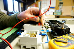 Testing wiring on electronic panel B Stock Photo