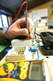 Testing wiring on electronic panel A Stock Photo