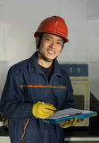 The testing worker is recording in laboratory. The tester is recording the data and smiling in the laboratory Stock Photography