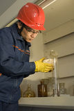 The testing worker is working in the laboratory stock image