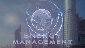 Testo della gestione dell'energia con l'ologramma 3d del pianeta Terra contro il contesto della metropoli moderna stock footage