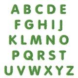 Testo della lettera dei cappucci di erba verde Immagini Stock Libere da Diritti