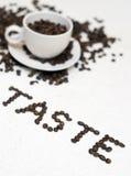 Testo della tazza di caffè - ?gusto? Fotografia Stock