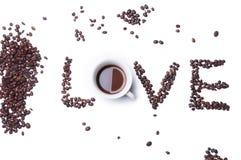 Testo di amore con i chicchi di caffè Fotografie Stock Libere da Diritti