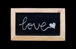 Testo di amore sul fondo nero del bordo Fotografie Stock