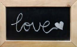 Testo di amore sul fondo nero del bordo Fotografia Stock