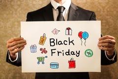 Testo di Black Friday con l'uomo d'affari Immagine Stock Libera da Diritti