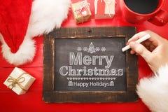 Testo di Buon Natale con la lavagna nera Fotografia Stock Libera da Diritti