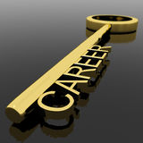 Testo di carriera su una chiave dell'oro con fondo nero come simbolo di nuovo Fotografia Stock