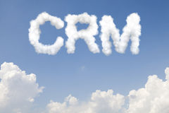 Testo di concetto di CRM in nuvole Immagini Stock Libere da Diritti