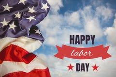 Testo di festa del lavoro sopra la bandiera degli Stati Uniti Fotografie Stock Libere da Diritti