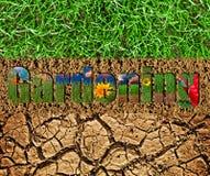 Testo di giardinaggio sul fondo dell'erba e del suolo Fotografia Stock