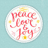 Testo di pace, di amore e di gioia Cartolina di Natale con Fotografia Stock