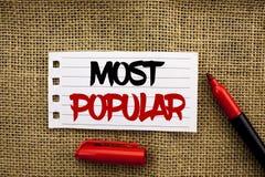 Testo di scrittura di parola più popolare Concetto di affari per il prodotto del bestseller superiore di valutazione o l'artista  immagine stock