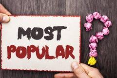 Testo di scrittura di parola più popolare Concetto di affari per il prodotto del bestseller superiore di valutazione o l'artista  immagine stock libera da diritti