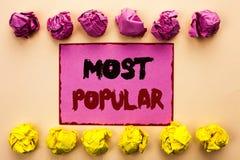 Testo di scrittura di parola più popolare Concetto di affari per il prodotto del bestseller superiore di valutazione o l'artista  fotografia stock libera da diritti
