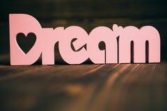 Testo di sogno su fondo di legno fotografia stock libera da diritti