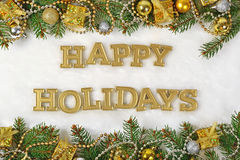Testo dorato di feste felici e ramo e decorazione attillati di Natale Fotografia Stock Libera da Diritti