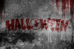 Testo felice di Halloween da sangue sulla vecchia parete spaventosa Fotografie Stock