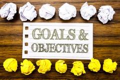 Testo scritto a mano che mostra gli obiettivi di scopi Concetto di affari per visione di successo di piano scritta sulla nota app Fotografia Stock Libera da Diritti