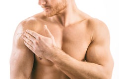 Testosterone Replacement Therapy TRT. Muscular man applying testosterone gel on shoulder stock photos