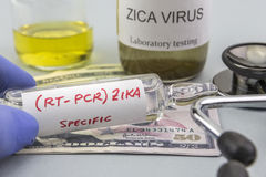 Tests for Research of ZIKA test and vials on tickets of dollar. Americans, concept of pharmaceutical copayment Royalty Free Stock Photos