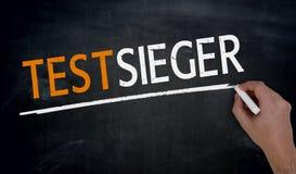 Testsieger in german Test winner is written by hand on blackbo Stock Images
