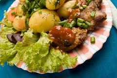 Testy dish. Cooked potatoes with fried liver decorated spring onion royalty free stock images